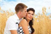 Couple in wheat — Stock Photo