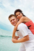 Man and woman on beach — Stock Photo
