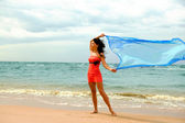 Gilr in the wind on the beach — Stock Photo