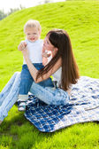 Mother with son outdoors — Stock Photo