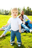Toddler and parents on grass — Stock Photo