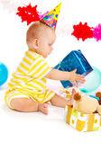 Baby with birthday present — Stock Photo