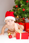 Kid in Christmas hat — Stock Photo