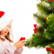 Decorating Christmas tree — Stock Photo #5770290