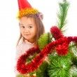 Decorating Christmas tree — Stock Photo #5770310