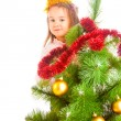 Decorating Christmas tree — Stock Photo #5770312