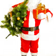 Santa with present and christmas tree — Stock Photo