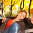 Young couple in autumn park — Stock Photo