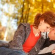 Stock Photo: Young couple in autumn park