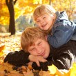 ������, ������: Daddy and doughter on autumn leaves