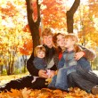 Stock Photo: Family on autumn leaves