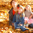 Royalty-Free Stock Photo: Mother and daughters in autumn leaves