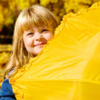 Preschool girl hiding — Stock Photo