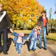 Stock Photo: Family in the autumn park