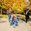 Parents and kids in park — Stock Photo