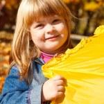 Playful girl with umbrella — Stock Photo #5770532