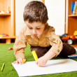 Boy drawing a picture — Stock Photo