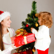 Royalty-Free Stock Photo: Opening Christmas present