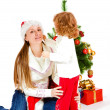 Daughter and mom in Christmas hat — Stock Photo