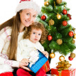 Mother and girl with presents — Stock Photo #5770803