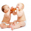 Babies eating a roll — Stock Photo