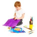 Boy cutting paper — Stock Photo