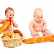 Babies eating bread — Stock Photo