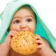 Baby eating bun — Stock Photo #5771352