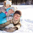 Family in winter park — Stock Photo