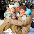 Family in winter park — Stock Photo #5771498