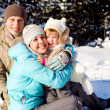Family playing in snow — Stock Photo #5771505
