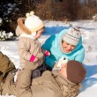 Family playing on snow — Stock Photo
