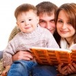 Parents reading to their kid — Stock Photo #5773997