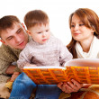 Parents reading to their kid — Stock Photo #5774036