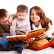 Stock Photo: Mom and dad reading for the kid