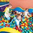 Kids in colorful balls — Stock Photo