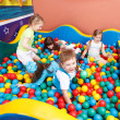 Stock Photo: Kids in colorful balls
