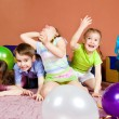 Kids playing with balloons — Stock Photo #5774626