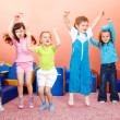 Preschoolers jumping - Stock Photo