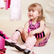 Girl trying on boots - Stock Photo