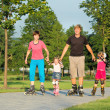 Parents and two daughters skating — Stock Photo #5774898