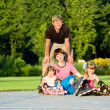 Family in roller skates — Stock Photo #5774910