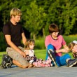 Parents and kids in roller skates — Stock Photo