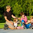 Family in roller skates — Stock Photo