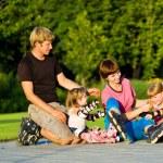 Family in roller skates — Stock Photo