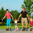 Family skating — Stock Photo