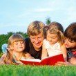 Parents reading book — Stock Photo