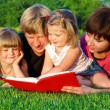 Parents and daughters reading — Stock Photo