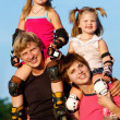 Parents and children in roller skates — Stock Photo #5774965