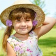 Girl in straw hat — Stock Photo